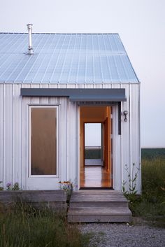 """""""There's a presence to that place—it's vast, and constantly shifting,"""" Moffitt says. """"It was clear that this house should be an observation shed for the changing landscape beyond."""" Tagged: Exterior, Metal Siding Material, and Gable RoofLine. Metal Siding, Metal Roof, Steel Roofing, Wood Shingles, Roofing Shingles, Shed Design, House Design, Great Wide Open, Modern Shed"""