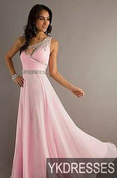 This pink is very delicate. I am not a fan of the cut on the top, but the jeweled belt defines a primitive waistline.