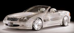 Mercedes SL600 covered in Swarowski Crystals...White fluffy seats included:-)