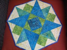 Batik twisted star quilted table topper octagonal by NannyGrans