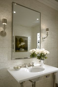 Look how great a Mosaic tile looks when used as a an accent wall.  Simple elegant texture to balance the smooth surfaces.