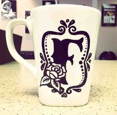 Hand-drawn Sharpie monogram baked onto coffee mug