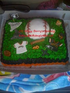 Baseball Theme cake I made for a office party.  Half the people liked the Giants, half like the Pirates.  Baseball is cake and covered in fondant.  Jersey shirts I made from fondant.