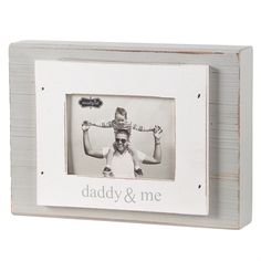 1 1/2' thick painted, distressed wood block frame features layered frame-on-frame construction with 'daddy