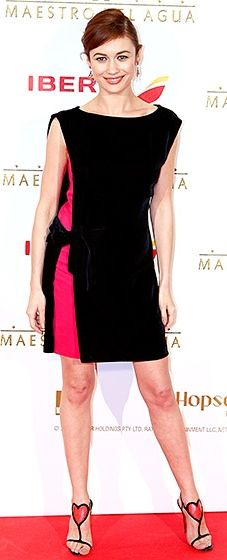 """Lovely! The star showed off her long legs in a black and pink Lanvin minidress with Christian Louboutin """"Cora"""" sandals."""