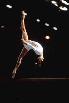 Nadia Comaneci in an aerial flic-flac on beam