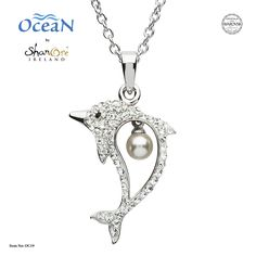 This dolphin and pearl pendant necklace is a cute and charming piece of jewelry that's as pretty as it is playful. Crafted in Sterling silver, its dolphin shaped pendant comes embellished with sparkling Swarovski® crystals. Ocean Jewelry, Dolphin Jewelry, Silver Pearls, Swarovski Pearls, White Gold Jewelry, Gold Jewellery, Pearl Pendant Necklace, Animal Jewelry, Jewelry Stores