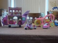 We are being invaded by Littlest Pet Shops.  They are arriving by plane, motor cycle, car, and paw paw cruiser.  Considering calling in the National Guard...