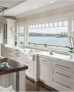 Stylish lakefront home with all white kitchen, marble countertops, and brass har. - Stylish lakefront home with all white kitchen, marble countertops, and brass hardware accents - Sweet Home, All White Kitchen, Classic White Kitchen, Lakefront Homes, Beach House Decor, Home Decor, Beach Houses, House On The Beach, Ocean House