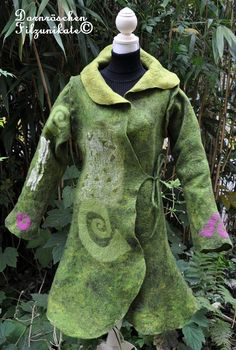 wonderful felted coat. $799.00, via Etsy.love the pre felted spirals