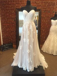 Light and airy boho wedding dress by Stella York. Lace appliqués cascade down a frothy tulle skirt. Finished with a beaded belt that accents the waist.