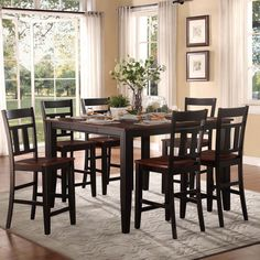 This modern Eli 7-piece dining set features elegant two-tone country-chic style. Made from solid Asian rubberwood with a rich cherry and black finish, this versatile set offers an extending table that is perfect for guests and family to gather around.