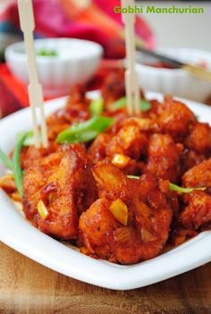 Gobhi Manchurian/Crispy Cauliflower in a spicy chilli-garlic sauce. Looks a little involved, but super tasty!