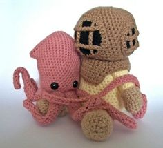 crochetempire:  Sometimes unexpected friendships are the most precious. This adorable little squid found a friend in a deep sea diver.