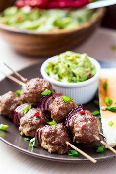 meat kebab beef balls on skewer with onions avocado sauce guacamole spring picnic Bbq Skewers, Kebabs, Dinner Is Served, High Tea, Guacamole, Good Food, Brunch, Food And Drink, Beef