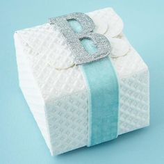 Personalize wrapped gifts with a decorated chipboard monogram letter. Paint or glitter the letter to coordinate with wrapping paper and ribbon.