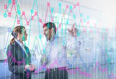 Businessman and businesswoman discussing graph on interactive display