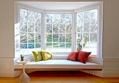 vintage style bench seat in a bay window is a great idea for decorating a home #lowe'shomeimprovementlocations,