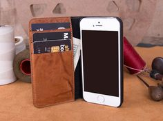 This product name is KEOPS  KEOPS suitable for iPhone 5/5S and iPhone SE ————————————————————— [ PRODUCT FEATURES ] ————————————————————— ● Made from very high quality genuine leather with soft suede micro fiber lining ● 100% Genuine leather ● High-quality leather ● Handmade item ● 3 credit card slots, each can hold multiple cards ● Holds 3 - 6 card ● 1 inner compartment for money or bill ● Handcrafted phone case for iPhone from high quality leather ● Extra strong padding ● The maximum…