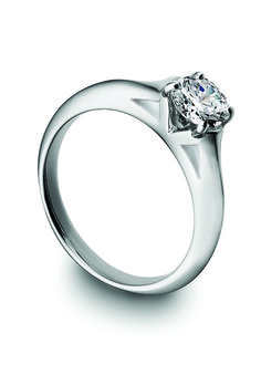 Platinum, round brilliant, four prongs by Bondanza. *The more prongs the more protection to your diamond, less protection may cause chips...sure you won't like it.