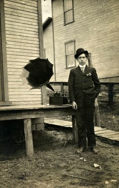 Young man posing with an Edison Cylinder Phonograph, c.1900.
