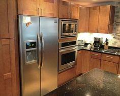 Refrigerator next to wall ovens