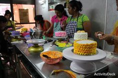 Students working on individual cake
