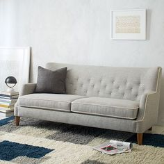Livingston Sofa. Its button tufting and laid back wingback frame is nostalgic, without feeling dated. Made in the USA. #westelm