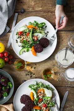 Beetroot and quinoa patties with spring oat salad and tahini dressing