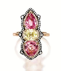 PADPARADSCHA SAPPHIRE AND DIAMOND RING, IVY.  Set with two pear-shaped padparadscha sapphires weighing 2.12 and 1.71 carats respectively, spaced by an oval diamond of light yellow hue weighing approximately 1.20 carats, framed by circular-cut diamonds, mounted in 18 karat pink and blackened gold, signed