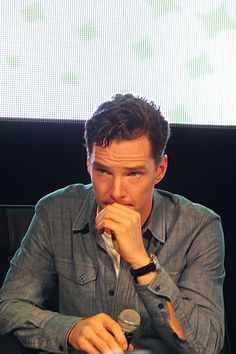 Benedict Cumberbatch touching his own mouth. you are welcome.