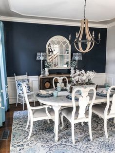 Navy paint on an accent wall brought a bold pop to my dining room transformation! Navy paint on an accent wall brought a bold pop to my dining room transformation! Dining Room Accent Wall, Elegant Dining Room, Dining Room Design, Dining Room Furniture, Blue Dining Room Walls, Modern Farmhouse Dining Room, Grey Dining Room, Dining Room Accents, Blue Accent Walls