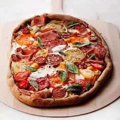 Healthy comfort food recipes: Basil and Tomato Pizza. So much healthier than take-out pizza, and even more delicious than what you get at your local Italian restaurant. | Health.com