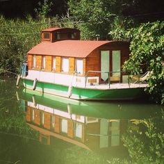 Barge House Boat with Curved Roof and Mollycroft Roof  |  TIMBER TRAILS:  Enabling cabin, cottage, and tiny house builders with resources for fast, efficient, and affordable housing alternatives.  Live Large -- Go Tiny!  > >  TimberTrails.TV