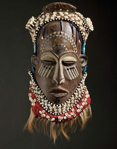 Origin not indicated.  The face resembles Yaure from the Ivory Coast, but the shell work resembles Kuba from DRC.