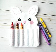 Crayon rolls have be come increasingly popular because children can easily use them and crayons are easy to take on the go. This Easter rabbit crayon roll can be added to any Easter basket to add excitement and fun on the big day. Pair this crayon roll with a holiday coloring book and give as a small gift to a budding artist. This rabbit crayon roll comes in white felt and features embroidered features. The body of the rabbit is created with two layers of high quality Ecofelt and an inside…