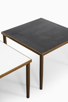 Teak side tables with black & white formica at Studio Schalling