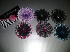 Mini Gerber Daisy - You pick the one you want, make it a clip. $5.00, via Etsy.