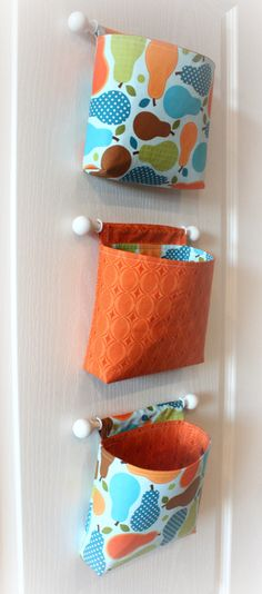 Super cute! Wall hanging organizers/storage...cute for back of the door in a kids room or bathroom