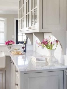 white marble countertop, gray kitchen cabinets.