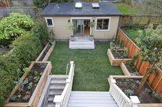 Choosing The Patio Design Using Planter Boxes To Maximize The Beauty : Wonderful Backyard Patio Ideas With Planter Boxes Also Planting Beds Plus Redwood Fence With Gable Roof And Potted Plants Plus Lanterns Also Glass Doors With Glass Window