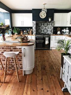 My completed paint and wallpaper job in the kitchen! Brick wallpaper, wooden floorboards, tiled backsplash, rangemaster oven, wooden countertops and copper accessories. #kitchen #rustickitchen #melaniejadedesign #homedecor #interiors #interiordesign #renovation #kitchenrenovation