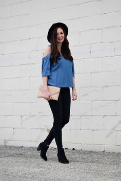 Chambray Cold Shoulder Top, Asos Blush Pink Envelope Clutch, Black Skinny Jeans, Black Booties, and Black Wool Fedora Outfit