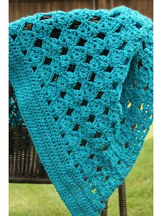 """This charming crochet blanket pattern is great for making for yourself, a new arrival or even as a holiday gift. Fast and easy-to-stitch, this fun pattern will keep you occupied without being too difficult. Size: 40"""" x 40"""". Made with medium (worsted) weight yarn and size H/8/5mm hook. Skill Level: Easy"""