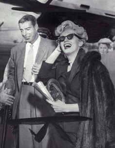 Marilyn and Joe DiMaggio leaving New York for LA after filming the famous skirt blowing up scene in The Seven Year Itch, January 16th 1954
