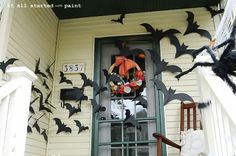 I did some of these inside last Halloween....but love the look of a large group in a doorway/entryway.  Time to buy more black posterboard.....