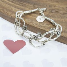 A Personalised Fine Silver 'Forget Me Knot' Bracelet by The Letteroom, the perfect gift for Explore more unique gifts in our curated marketplace. Bracelet Making, Hand Stamped, Gifts For Him, Personalized Gifts, Unique Gifts, Initials, Forget, Product Photography, Twists