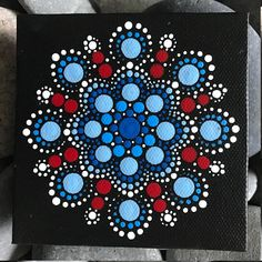 For sale is a hand-painted Mandala on a 4x4 canvas. Painted with high-quality acrylic paints, with a gloss acrylic finish for protection. Colors in this Mandala are Red, White and Blue. Each one is hand made and no two are alike