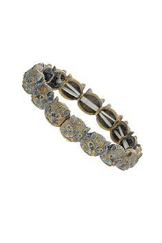 22 Stackable Bracelets To Jazz Up Any Ensemble #refinery29  http://www.refinery29.com/stackable-bracelets#slide3  Top Shop, Cat Bracelet, $20, available at Top Shop.