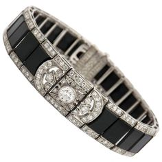 Art Deco Onyx Diamond Platinum Bracelet, circa 1925.